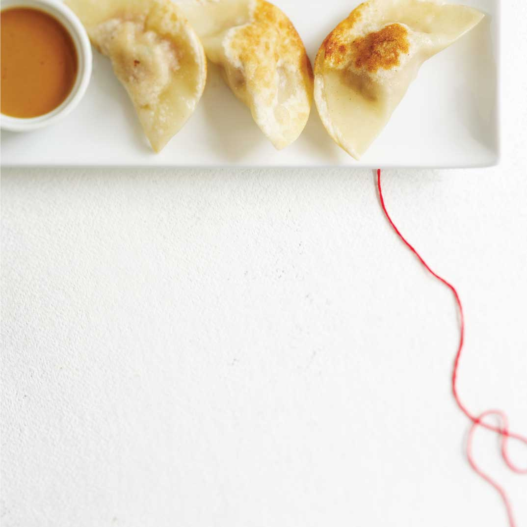 Pork Dumplings with Peanut Sauce