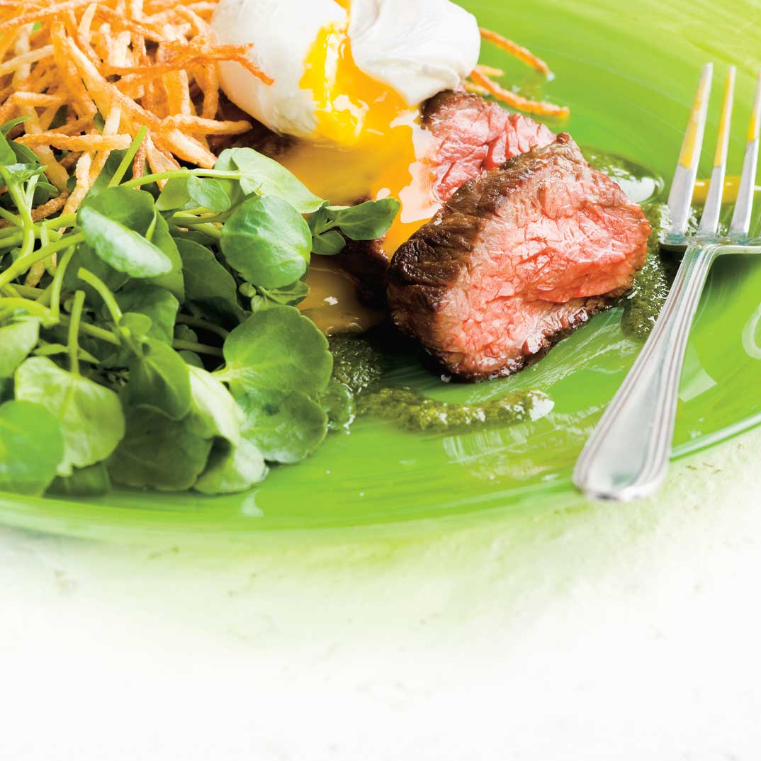 Grilled Skirt Steaks with Eggs, Watercress Dressing and Shoestring Fries