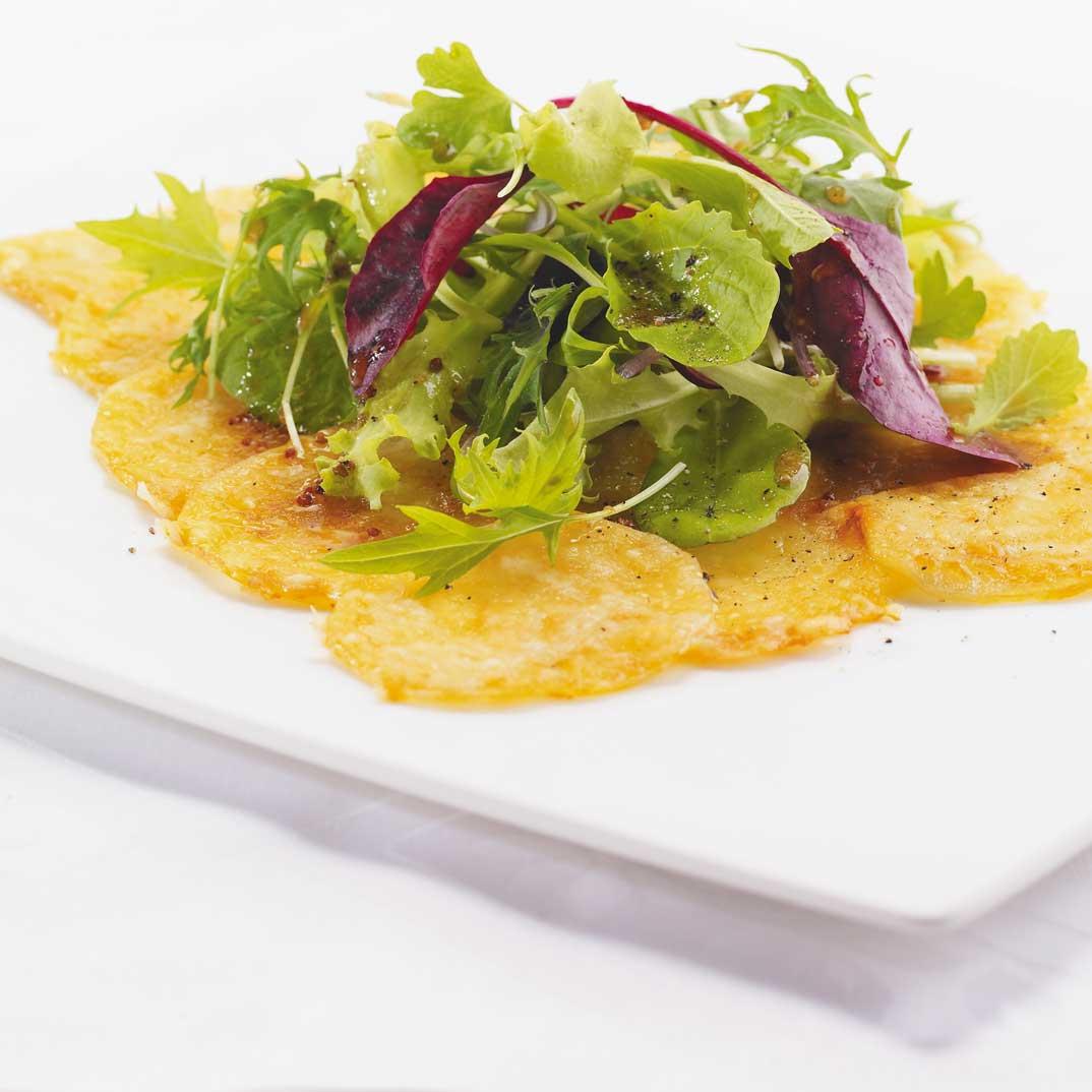 Tarte fine de pommes de terre et fromage gruyère
