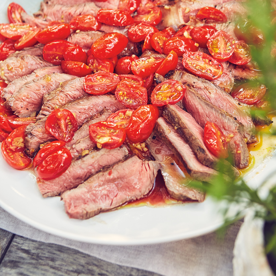Steaks with Toasted Garlic and Stewed Cherry Tomatoes