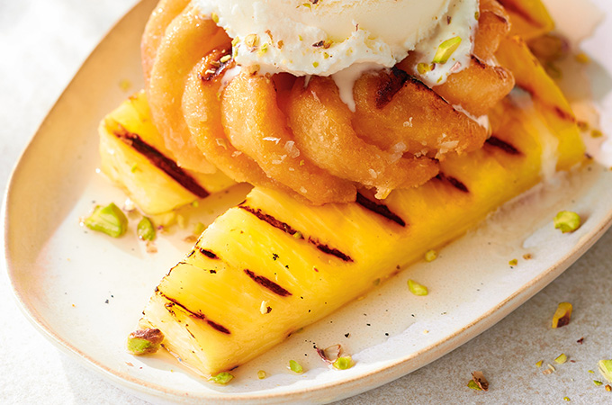 Grilled Pineapple and Doughnuts with Spiced Rum Syrup